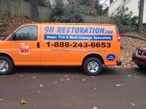 Water Damage Restoration Van At Fall Residential Job Site Wtih Fallen Leaves