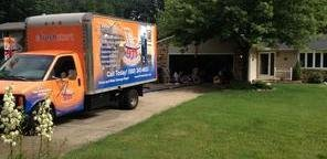 Mold Damage Restoration Truck Parked Near Lawn