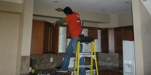 Water Damage Restoration Being Conducted On Soaked Ceiling