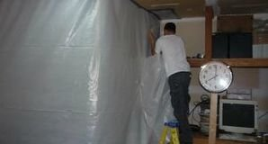 Technician Setting Up Vapor Barrier For Mold Removal