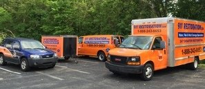 Water Damage and Mold Removal Vehicles Waiting To Go To Remediation Job