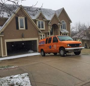 Water Damage And Mold Repair Team At Residential Property